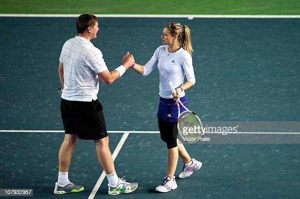 Maria Kirilenko and Yevgeny Kafelnikov of Russia celebrate match point on their doubles match against Aravane Rezai of France and Stefan Edberg of...
