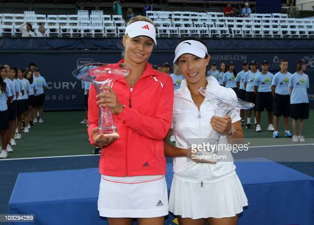 Maria Kirilenko of Russia and Jie Zheng of China pose with their trophies after defeating Lisa Raymond of the USA and Renae Stubbs of Australia...
