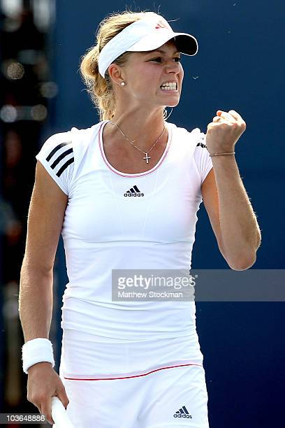 Maria Kirilenko of Russia celebrates a point against Dinara Safina of Russia during the Pilot Pen tennis tournament at the Connecticut Tennis Center...