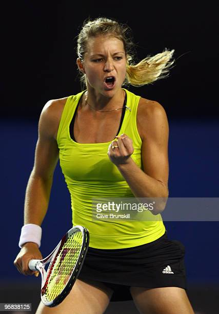 Maria Kirilenko of Russia celebrates winning a point in her first round match against Maria Sharapova of Russia during day one of the 2010 Australian...