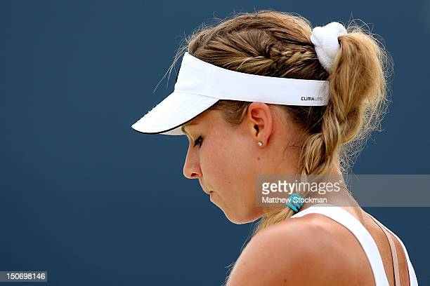 Maria Kirilenko of Russia cools down between games while playing Caroline Wozniacki of Denmark during the semifinals of the New Haven Open at Yale at...