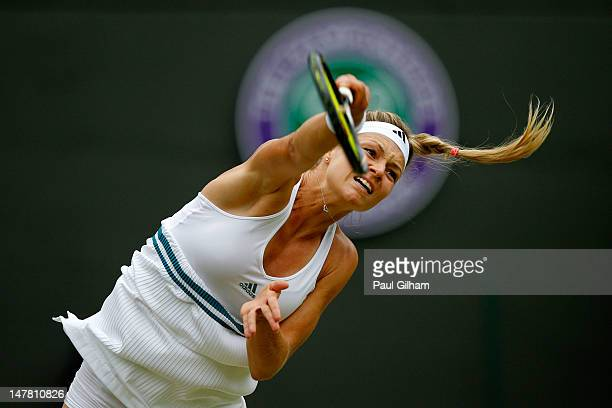 Maria Kirilenko of Russia in action during her Ladies' Singles quarterfinal match against Agnieszka Radwanska of Poland on day eight of the Wimbledon...