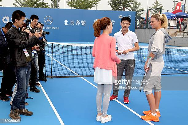 Maria Kirilenko of Russia meets with representatives of MercedesBenz during day one of the 2013 China Open on September 28 2013 in Beijing China