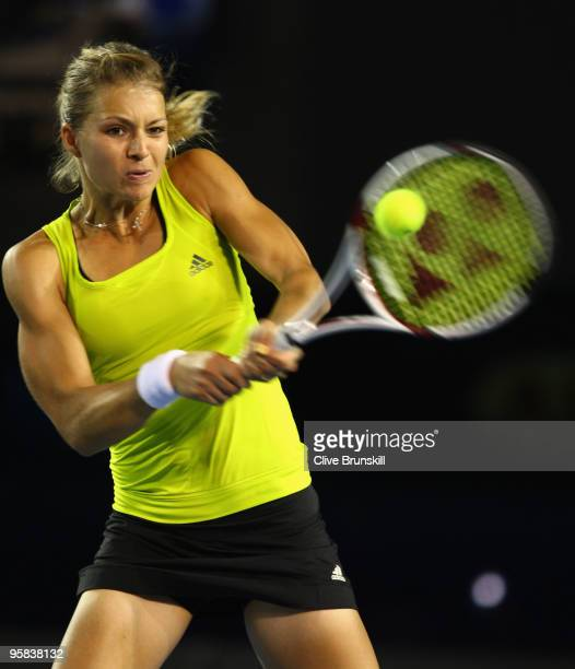 Maria Kirilenko of Russia plays a backhand in her first round match against Maria Sharapova of Russia during day one of the 2010 Australian Open at...
