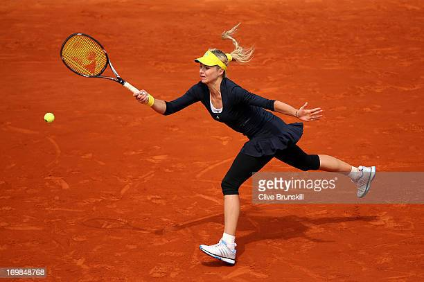 Maria Kirilenko of Russia plays a forehand during her Women's Singles match against Bethanie Mattek-Sands of the United States of America on day nine...