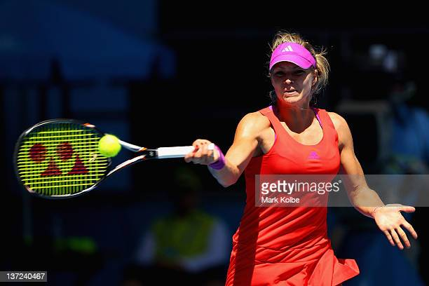 Maria Kirilenko of Russia plays a forehand in her first round match against Jarmila Gajdosova of Australia during day two of the 2012 Australian Open...