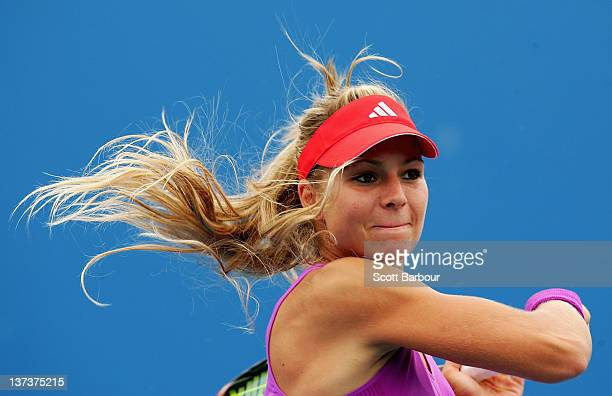 Maria Kirilenko of Russia plays a forehand in her second round doubles match with Nadia Petrova of Russia against Klaudia Jans-Ignacik and Urszula...