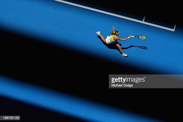 Maria Kirilenko of Russia plays a forehand in her third round match against Yanina Wickmayer of Belarus during day six of the 2013 Australian Open at...