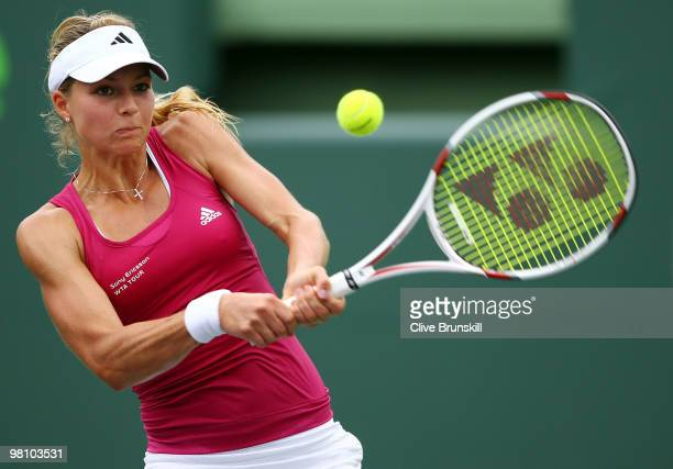 Maria Kirilenko of Russia returns a shot against Caroline Wozniacki of Denmark during day six of the 2010 Sony Ericsson Open at Crandon Park Tennis...