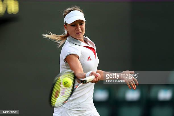 Maria Kirilenko of Russia returns a shot against Heather Watson of Great Britain during the second round of Women's Singles Tennis on Day 4 of the...