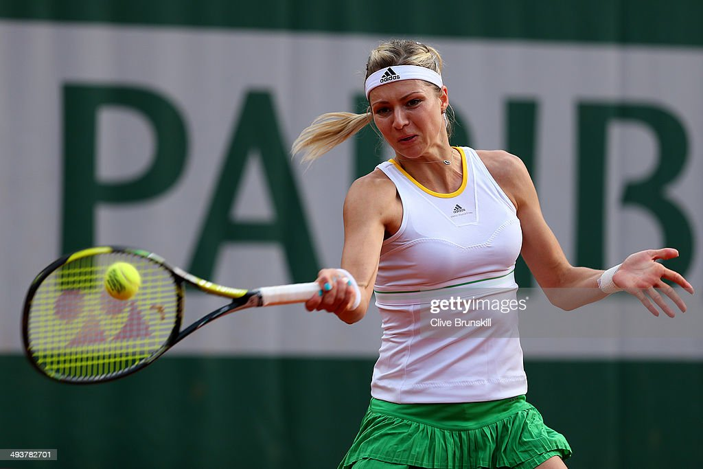 Maria Kirilenko of Russia returns a shot during her women's singles match against Johanna Larsson of Sweden on day one of the French Open at Roland Garros on May 25, 2014 in Paris, France.