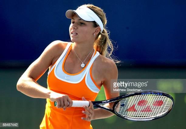 Maria Kirilenko of Russia returns a shot to Anna Chakvetadze of Russia during the Pilot Pen Tennis tournament August 24 2005 at the Connecticut...