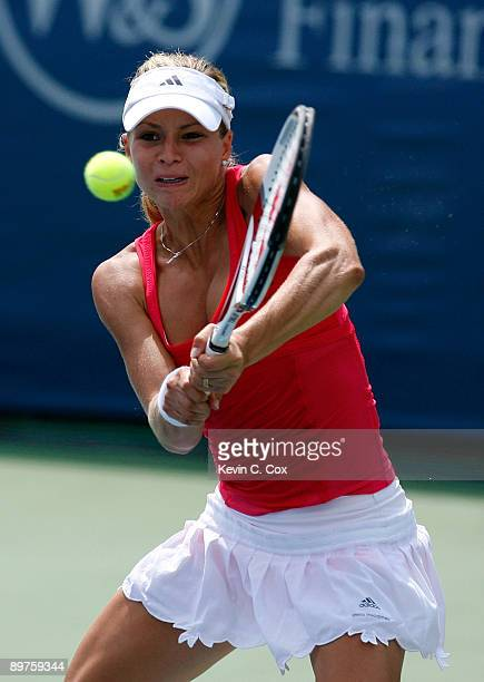 Maria Kirilenko of Russia returns a shot to Jelena Jankovic of Serbia during Day 3 of the Western Southern Financial Group Women's Open on August 12...