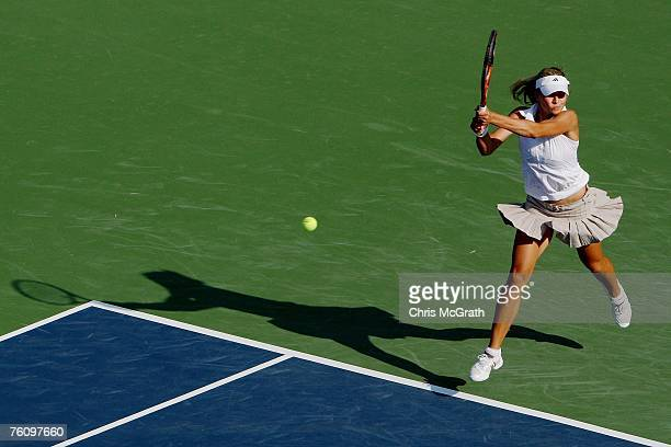 Maria Kirilenko of Russia returns a shot to Martina Muller of Germany during the Rogers Cup August 14 2007 at the Rexall Center in Toronto Ontario...