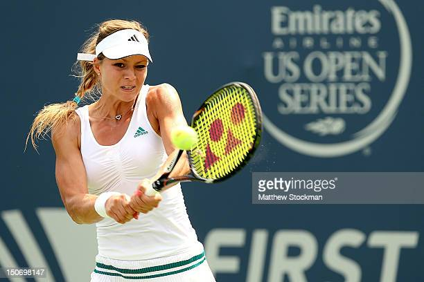 Maria Kirilenko of Russia returns shot to Caroline Wozniacki of Denmark during the semifinals of the New Haven Open at Yale at the Connecticut Tennis...