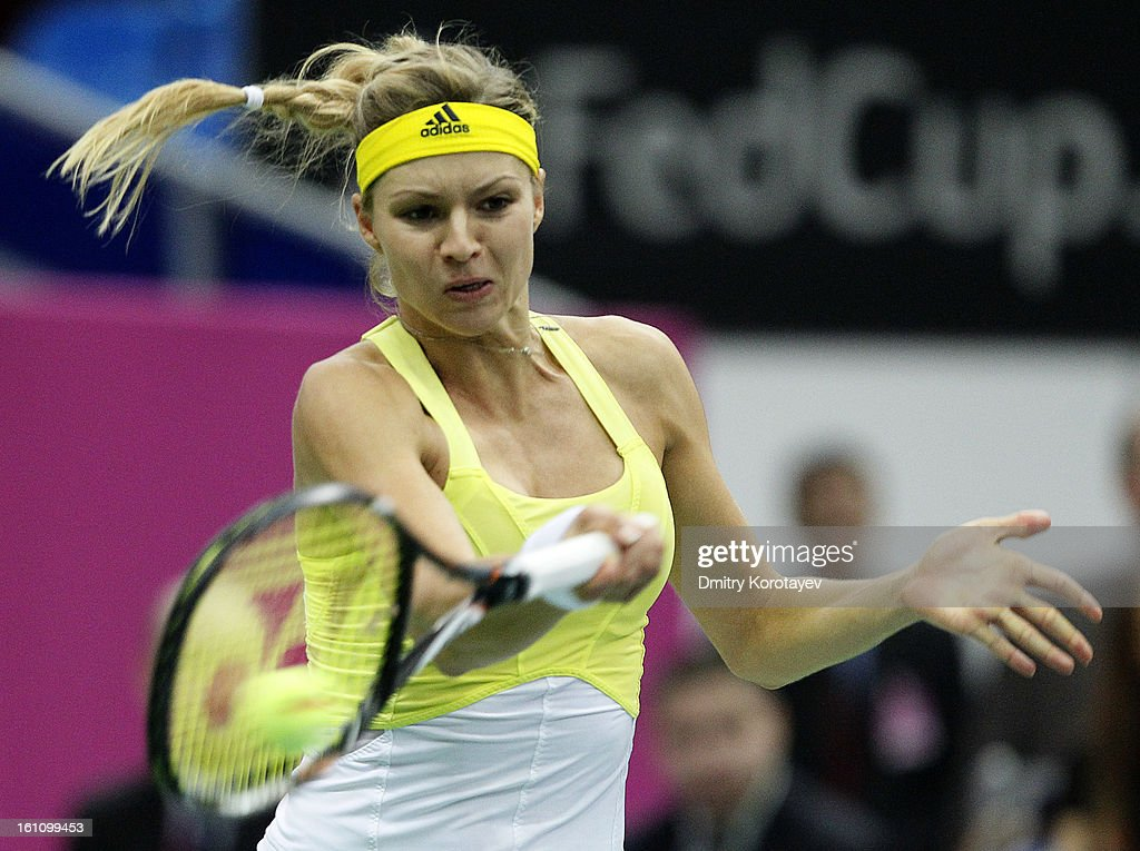 Maria Kirilenko of Russia returns the ball against Kimiko Date-Krumm of Japan during day one of the Federation Cup 2013 World Group Quarterfinal match between Russia and Japan at Olympic Stadium on February 09, 2013 in Moscow, Russia.