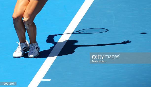 Maria Kirilenko of Russia serves in her first round match against Olivia Rogowska of Australia during day one of the Sydney International at Sydney...