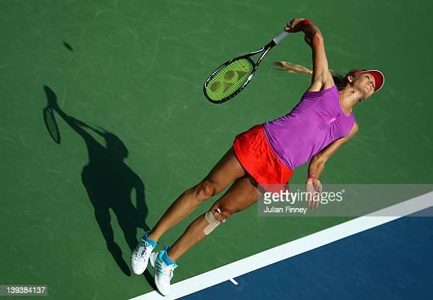 Maria Kirilenko of Russia serves to Monica Niculescu of Romania during day one of the WTA Dubai Duty Free Tennis Championship on February 20, 2012 in...