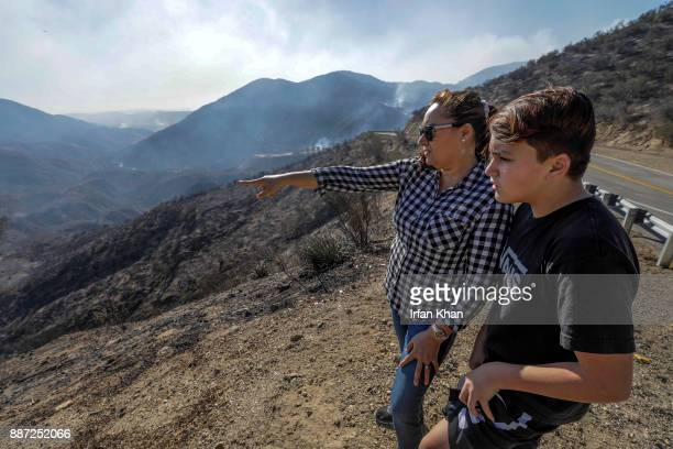 Maria Kirkland left with her son points towards her husband who walked deep down in Indian Spring Ranch to check on their home Later ShastaTrinity...