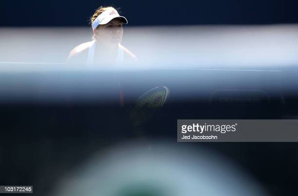 Maria Kirlienko of Russia in action against Agnieszka Radwanska of Poland during the quarterfinals of the Bank of the West Classic at Stanford...