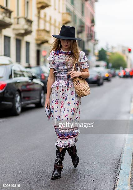 Maria Kolosova wearing cowboy boots and dress is seen outside Wunderkind during Milan Fashion Week Spring/Summer 2017 on September 21 2016 in Milan...