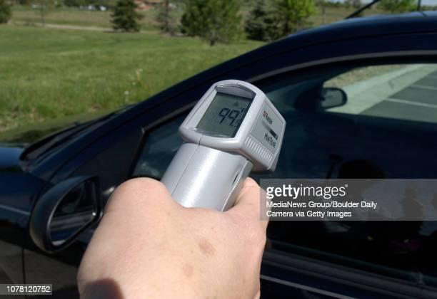 Maria Kunzel Broomfield police animal control officer measures the shaded temperature inside a car parked in the sun on Friday The temperature was...