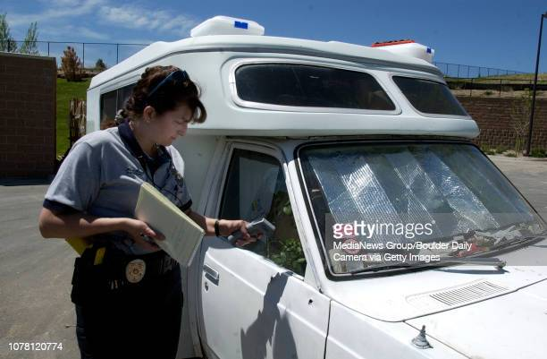 Maria Kunzel Broomfield police animal control officer measures the shaded temperature inside a small truck before rescuing a dog in the vehicle...