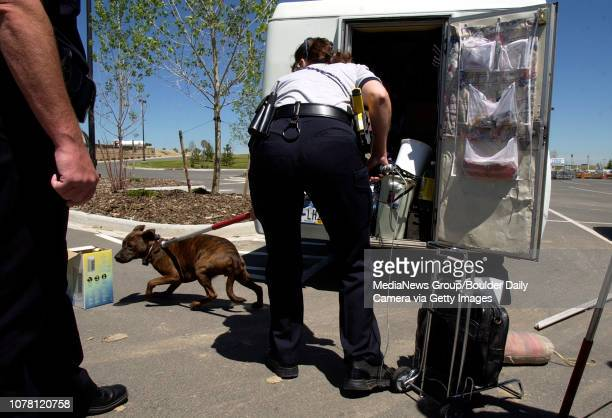 Maria Kunzel Broomfield police animal control officer rescues a dog that was locked inside a truck parked in the sun at the Walmart store on Friday