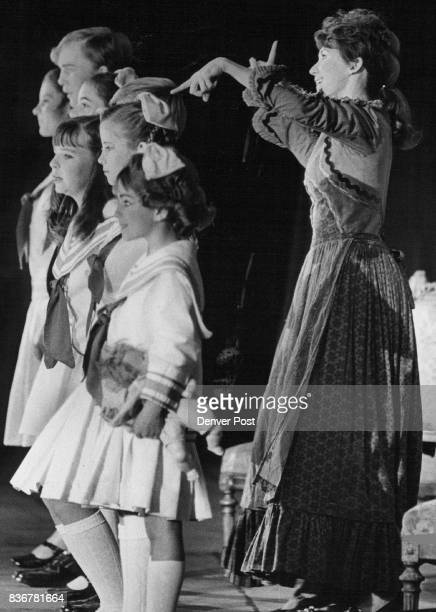 Maria Leads Von Trapp Children In Song Scene of them singing Do Re Me is from Cheesman Park musical Sound of Music Credit Denver Post