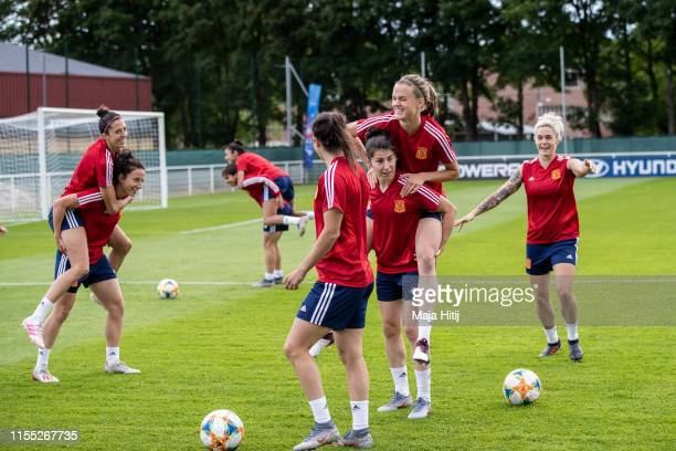 Maria Leon , Irene Paredes and Lucia Garcia of Spain warm up during a Spain Training session on June 11, 2019 in Lille, France.