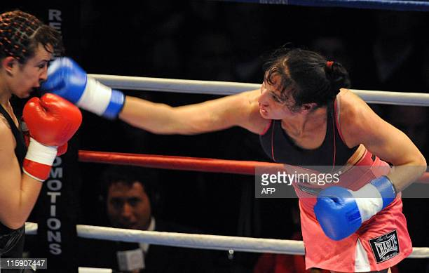 Maria Loli Munoz of Spain punches Chris Namus of Uruguay in their WPBF light welterweight world title fight in Montevideo late on June 11 2011 Namus...
