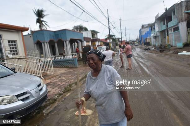 Maria Lopez cries while walking from her house that was flooded after the passage of Hurricane Maria in Toa Baja Puerto Rico on September 22 2017...
