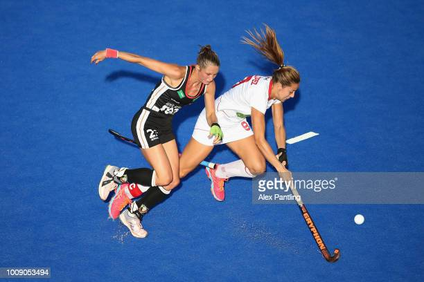 Maria Lopez of Spain and Cecile Pieper of Germany clash during the quarter final game between Germany and Spain of the FIH Womens Hockey World Cup at...