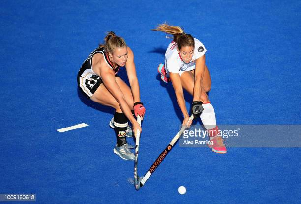 Maria Lopez of Spain and Lena Micheel of Germany in action during the quarter final game between Germany and Spain of the FIH Womens Hockey World Cup...