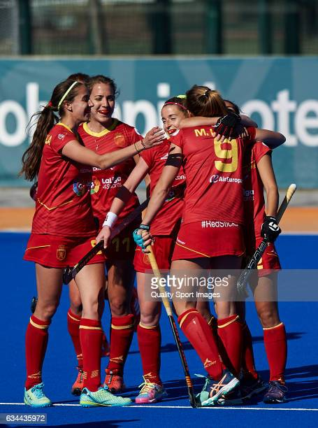 Maria Lopez of Spain celebrates with her teammates after score the fourth goal during the match between Spain and Ghana during day four of the Hockey...