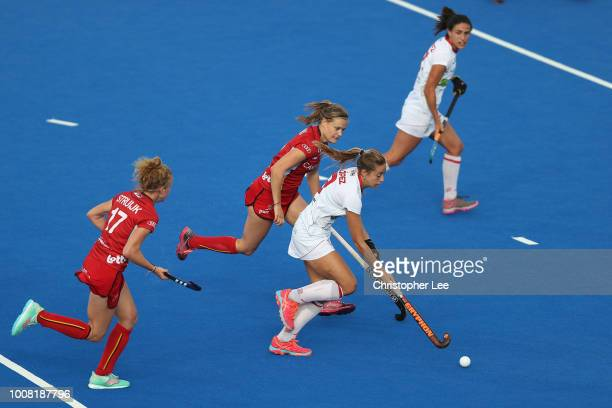 Maria Lopez of Spain gets away from AnneSophie Weyns of Belgium during the Crossover game between Belgium and Spain of the FIH Womens Hockey World...