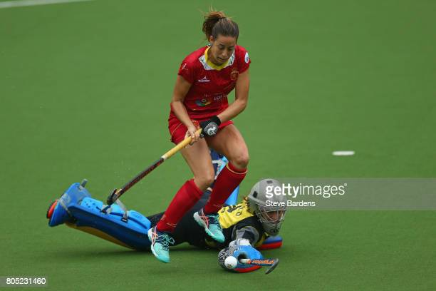 Maria Lopez of Spain goes around Martina Chico of Italy to score during the penalty shoot out during the Fintro Hockey World League 5/8 place playoff...