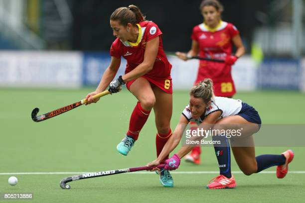 Maria Lopez of Spain is tackled by Celina Traverso of Italy during the Fintro Hockey World League 5/8 place playoff game between Spain and Italy on...