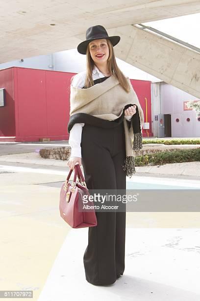 Maria Luisa Valdivieso wears Zara pants Zara shirt Zara scarf Liujo handbag and Vintage hat during Mercedes Benz Fashion Week at Ifema on February 19...