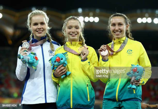 Maria Lyle of Scotland gold medalist Isis Holt of Australia and silver mealist Brianna Coop of Australia during athletics on day seven of the Gold...