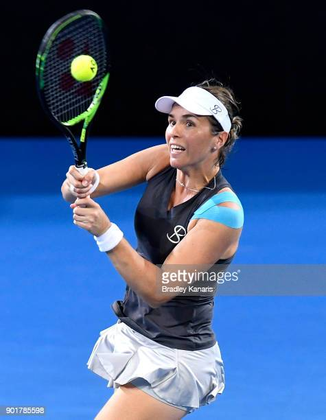 Maria Martinez Sanchez of Spain plays a backhand in her match with Andreja Klepac of Slovakia in the WomenÕs Doubles Final match against Kiki Bertens...