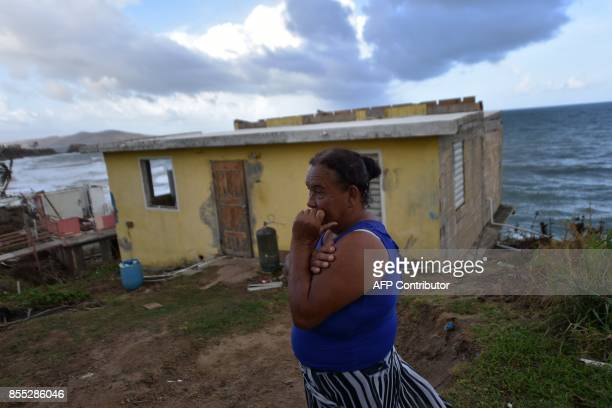 Maria Martinez stands next to her house which was damaged by Hurricane Maria in Yabucoa in eastern Puerto Rico on September 28 2017 A week after the...