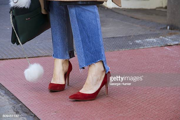 Maria McManus seen at The Apartment by The Line outside the Protagonist presentation wearing red shoes ripped jeans and Cline bag with white fur pom...
