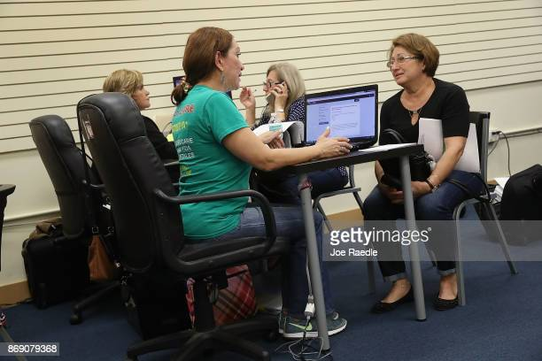 Maria Mena an insurance agent from Sunshine Life and Health Advisors speaks with Elena Blondin as she shops for insurance under the Affordable Care...