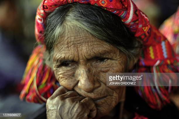 Maria Mendoza Agustin waits for the exumation of her relatives, victims of the Guatemalan civil war , buried in a common grave found on September 30,...
