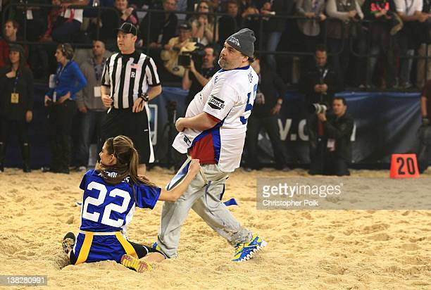 Maria Menounos and Artie Lange play at DIRECTV's Sixth Annual Celebrity Beach Bowl Game at Victory Field on February 4 2012 in Indianapolis Indiana