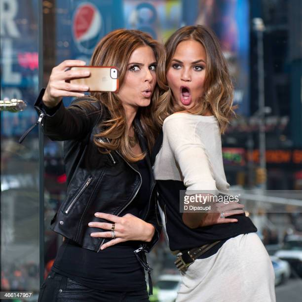 "Maria Menounos and Chrissie Teigen visit ""Extra"" in Times Square on January 31, 2014 in New York City."