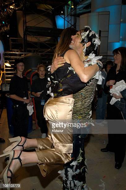 Maria Menounos and Jim Carrey during Nickelodeon Kids Choice Awards 2003 Backstage at Barker Hangar in Santa Monica California United States