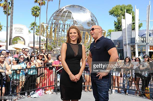 Maria Menounos and Vin Diesel visit 'Extra' at Universal Studios Hollywood on September 4 2013 in Universal City California