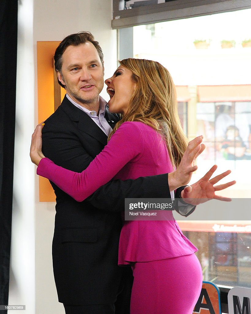 Maria Menounos impersonates a zombie with David Morrissey at Extra at The Grove on February 5, 2013 in Los Angeles, California.
